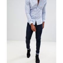 ASOS DESIGN super skinny jeans in raw blue - Blue