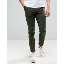 ASOS DESIGN - Skinny chino in donkerkaki - Bosnacht